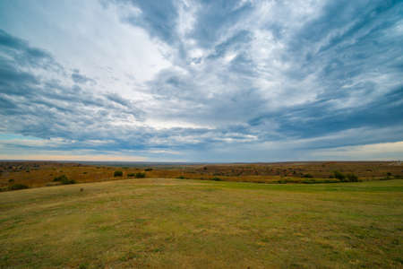 Wide Texan rural landscape under cloudy sky of stratus cloud formation.