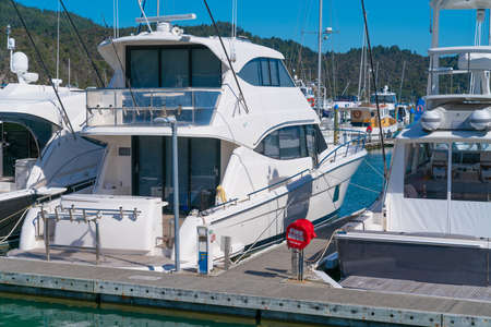 Luxury launches tied up in their marina berths create a display of affluence