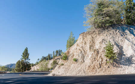 Winding road climbing into the San Bernardino National Forest towards Pacific Coast