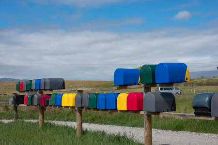 Rows if multi-colored rural letterboxes on country road. 版權商用圖片