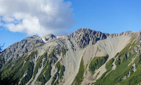 Hillsides slipping away as scree slides endlessly down in Southern Alps, New Zealand.