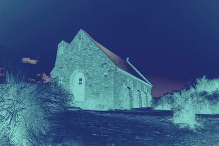 Night color gradient effect of historic small quaint stone Church of Good Sheppard in Tekapo New Zealand.