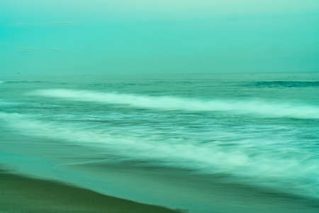 Abstract coastal imageryfor background or spiritual usemotion blur effect in green tones 版權商用圖片