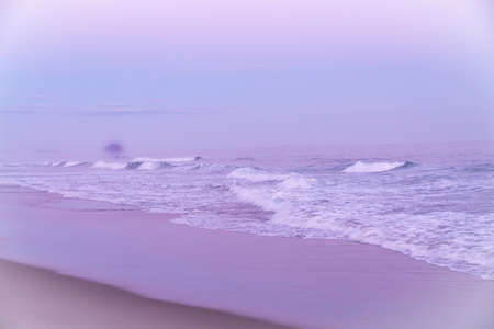 Abstract coastal imageryfor background or spiritual use motion blur effect in soft pink and blue tones.