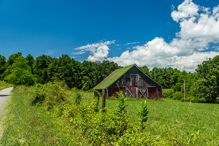 blue ridge: A view of an old barn in the foothills of the Blue Ridge Mountains in Floyd County, Virginia