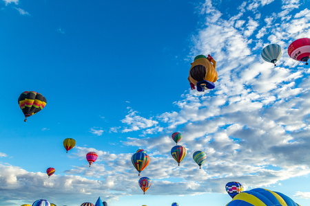 Hot Air Balloons fly over the city of Albuquerque, New Mexico during the mass ascension at the annual International Hot Air Balloon Fiesta in October, 2016 Editorial