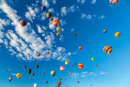 albuquerque: Hot Air Balloons fly over the city of Albuquerque, New Mexico during the mass ascension at the annual International Hot Air Balloon Fiesta in October, 2016 Editorial