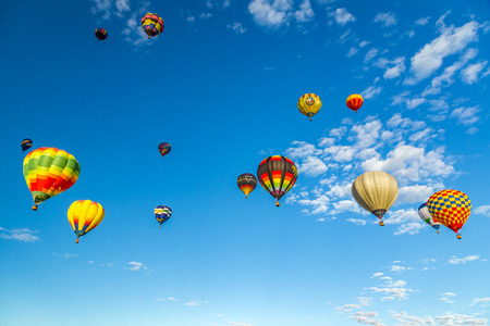 Hot Air Balloons fly over the city of Albuquerque, New Mexico during the mass ascension at the annual International Hot Air Balloon Fiesta in October, 2016 Stock Photo