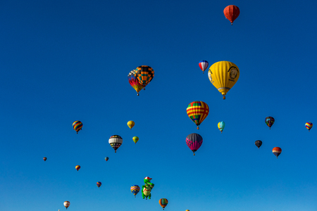 albuquerque: Hot Air Balloons fly over the city of Albuquerque, New Mexico during the mass ascension at the annual International Hot Air Balloon Fiesta in October, 2016 Stock Photo
