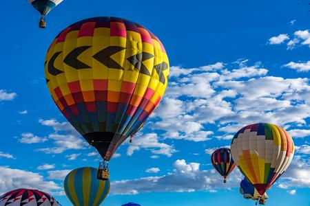 Hot Air Balloons fly over the city of Albuquerque, New Mexico Stock Photo