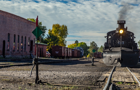 narrowgauge: A steam locomotive pulls a train out of the Chama, New Mexico depot