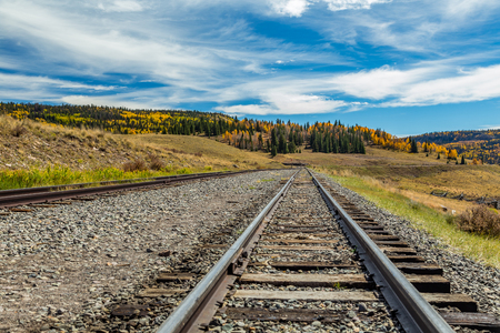 A view down narrow gauge railroad tracks located in the San Juan National Forest Stock Photo
