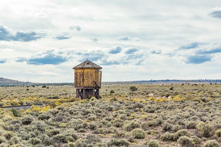 replenish: A water tower sits along the tracks of a narrow gauge railroad to replenish the water supply for steam locomotives