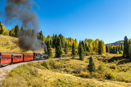 a Cumbres & Toltec steam locomotive pulls a train from Chama, New Mexico through a beautiful scenic mountain route ending in Antonito, Colorado Editorial