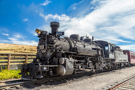 A steam locomotive belonging to the Cumbres & Toltec Railroad sits at the depot in Osier, Colorado midway through trip in the San Juan National Forest between Chama, New Mexico and Antonito, Colorado Editorial
