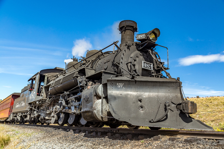 forest railroad: A steam locomotive belonging to the Cumbres & Toltec Railroad sits at the depot in Osier, Colorado midway through trip in the San Juan National Forest between Chama, New Mexico and Antonito, Colorado Editorial
