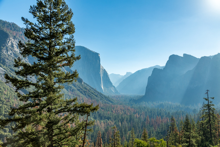 documented: Tunnel View is a scenic overlook on State Route 41 in Yosemite National Park. The iconic and expansive view of Yosemite Valley from the view point have been seen and documented by visitors since it opened in 1933. Internationally renowned artists to casua Stock Photo