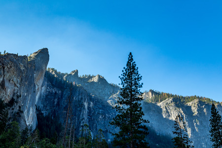bridalveil fall: The Leaning Tower in Yosemite National Park is a popular destination for rock climbers. It is located west of, and adjacent to Bridalveil Fall, on the south side of the Merced River in Yosemite Valley. The rock is considered to be a strenuous climb, requi