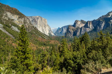 Tunnel View is a scenic overlook on State Route 41 in Yosemite National Park. The iconic and expansive view of Yosemite Valley from the view point have been seen and documented by visitors since it opened in 1933. Internationally renowned artists to casua Stock Photo