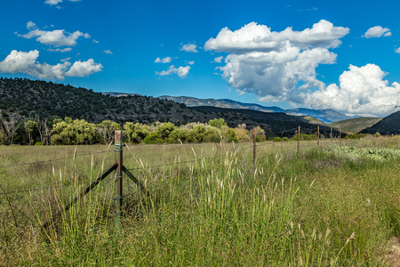 fenceline: A view of the Capitan Mountains in south central New Mexico from along the Billy the Kid Trail in Lincoln County. Stock Photo