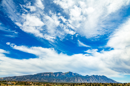 A view of Palomas Peak in the Sandia Mountains near Bernalillo, New Mexico. Banco de Imagens