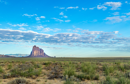 Shiprock (Navajo: Tsé Bit'a'í, rock with wings or winged rock is a monadnock rising nearly 1,583 feet (482.5 m) above the high-desert plain of the Navajo Nation in San Juan County, New Mexico, United States. Its peak elevation is 7,177 fee