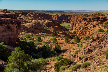 The Canyon de Chelly National Monument consists of many well-preserved Anasazi ruins and spectacular sheer red cliffs that rise up to 1000 feet.