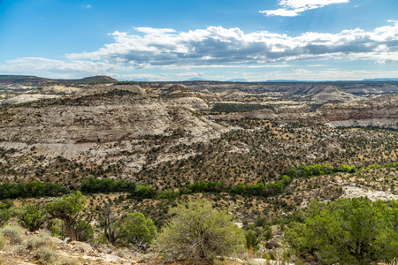From a stretch of Scenic Route 12 known as The Hogback, tree lined Boulder Creek meanders past Durffey Mesa in the Grand Staircase - Escalante National Monument in Utah. Stock Photo