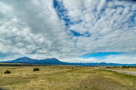 The Spanish Peaks are a pair of prominent mountains located in southwestern Huerfano County, Colorado. The Ute Indians named them Huajatolla (pronounced Wa-ha-toy-a), meaning two breasts or breasts of the Earth. West Spanish Peak is the easternmost mo