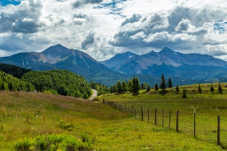 The San Juan Skyway forms a 233 mile loop in southwest Colorado traversing the heart of the San Juan Mountains festuring breathtaking mountain views and includes the portion of US 550 between Silverton and Ouray known as the Million Dollar Highway. Stock Photo