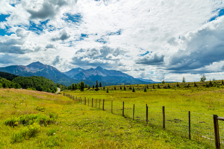 The San Juan Skyway forms a 233 mile loop in southwest Colorado traversing the heart of the San Juan Mountains festuring breathtaking mountain views and includes the portion of US 550 between Silverton and Ouray known as the Million Dollar Highway. Фото со стока