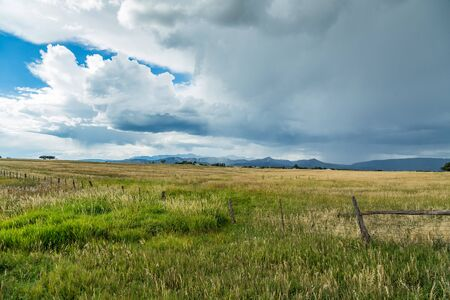 A thunder storm approaches from the mountains along US Highway 160 in Colorado. Stock Photo