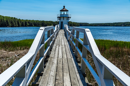 Doubling Point Light is a lighthouse on the Kennebec River in Arrowsic, Maine. It was established in 1898, fifteen years after the founding of the Bath Iron Works, a major shipbuilder, 1.5 miles upriver. Stock Photo