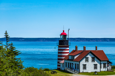 West Quoddy Head, in Quoddy Head State Park, Lubec, Maine, is the easternmost point of the contiguous United States. Since 1808, there has been a lighthouse there to guide ships through the Quoddy Narrows. The current one, with distinctive red-and-white s
