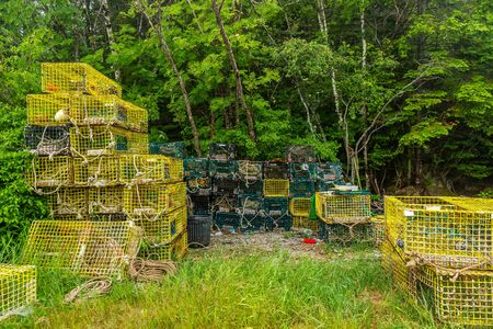 Lobster Traps await their next trip under the sea on the Schoodic Peninsula. Stock Photo
