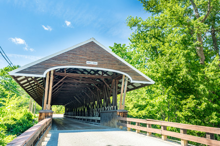 Rowell Covered Bridge is a covered bridge in Hopkinton, New Hampshire which carries Rowell Bridge Road over the Contoocook River. It is a long truss style bridge. Фото со стока