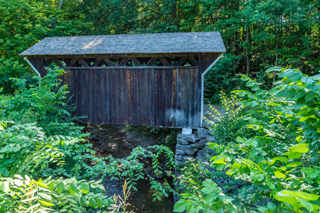 The Prentiss Bridge is the smallest bridge in New Hampshire at a length of only 36 feet. Spanning the Great Brook on the Old Cheshire Turnpike near the town of Langdon, New Hampshire, it was built in 1791 at a cost of 6 pounds.