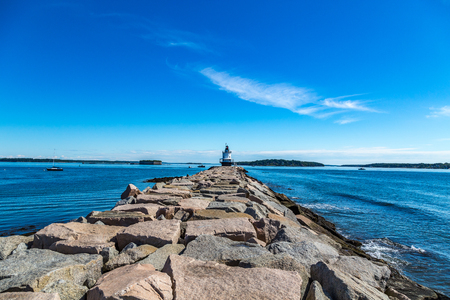 Spring Point Ledge Light is a sparkplug lighthouse in South Portland, Maine that marks a dangerous obstruction on the west side of the main shipping channel into Portland Harbor. It is now adjacent to the campus of Southern Maine Community College.