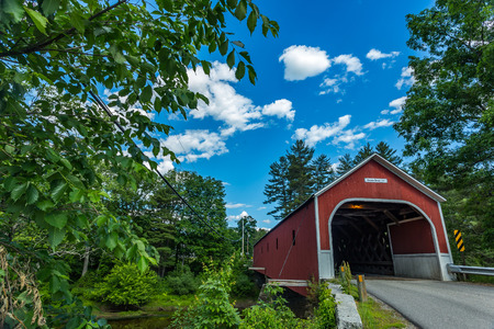 The Sawyers Crossing Covered Bridge, also known as the Cresson Bridge, is a wooden covered bridge carrying Sawyers Crossing Road over the Ashuelot River in northern Swanzey, New Hampshire. Stock Photo