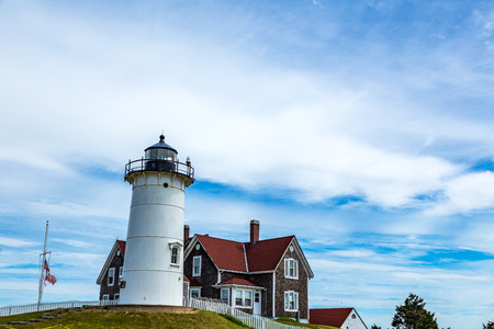 cod hole: Nobska Light, or Nobsque Light, also known as Nobska Point Light is a lighthouse located at the division between Buzzards Bay and Vineyard Sound in Woods Hole, Massachusetts on the southwestern tip of Cape Cod, Massachusetts. Stock Photo