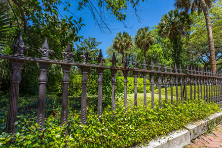 An old ironwork fence in the downtown historic district of Savannah, Georgia. Stock Photo