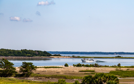 trawl: A shrimp boat trawls at the mouth of the Savannah River near the Atlantic Ocean.