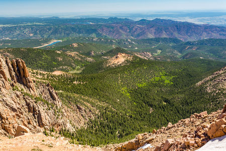 Pikes Peak is the highest summit of the southern Front Range of the Rocky Mountains. The ultra-prominent fourteener is located in Pike National Forest, 12 miles west of downtown Colorado Springs. The mountain is named in honor of American explorer Zebulon Stock Photo - 83911606