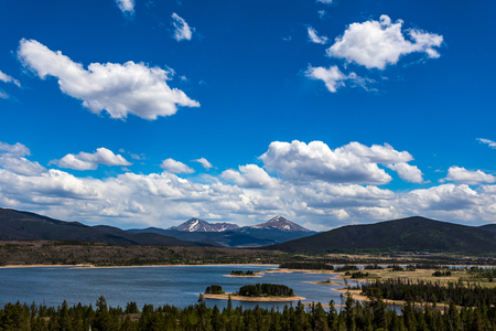 Dillon Reservoir, sometimes referred to as Lake Dillon, is a large fresh water reservoir located in Summit County, Colorado, and is a reservoir for the city of Denver. Popular ski areas are close to the reservoir, including Copper Mountain, Keystone, Arap Stock Photo