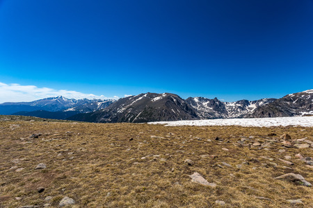 Trail Ridge Road is the name for a stretch of U.S. Highway 34 that traverses Rocky Mountain National Park from Estes Park, Colorado in the east to Grand Lake, Colorado in the west offering stunning mountain views.