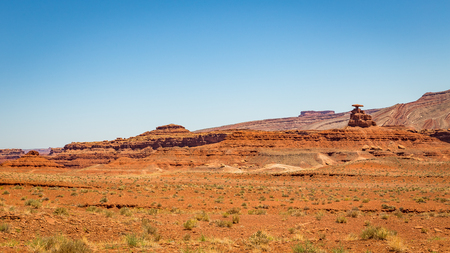 shaped: mexican Hat is a curiously sombrero-shaped rock outcropping in southwestern Utah. The rock measures 60 feet across. The Hat has two rock climbing routes ascending it. Stock Photo