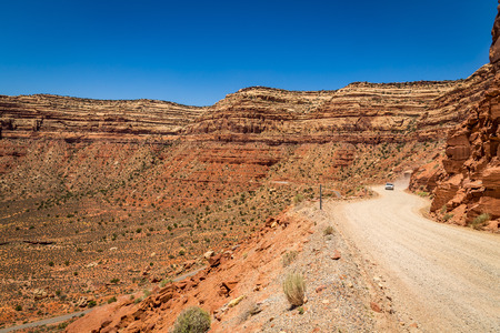 The Moki Dugway, located on Utah Route 261 just north of Mexican Hat, Utah is a staggering, graded dirt switchback road carved into the face of the cliff edge of Cedar Mesa. It consists of 3 miles of steep, unpaved, but well graded switchbacks (11% grade)