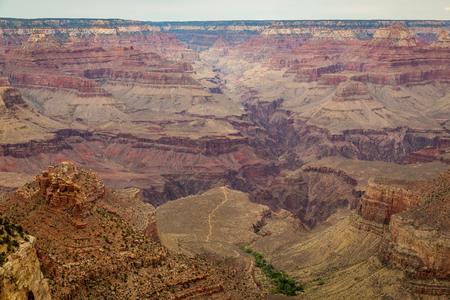 Along the Grand Canyon National Park in Arizona there are multiple lookouts and overlooks to see down into the canyon. Фото со стока