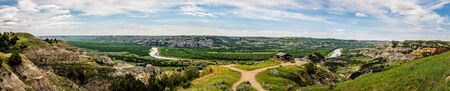 A panoramic view of River Bend Overlook at the North Unit of Theodore Roosevelt National Park in North Dakota. Фото со стока