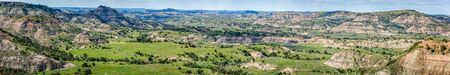 A panoramic view from the Painted Canyon Overlook in the South Unit of Theodore Roosevelt National Park near Medora, North Dakota. Фото со стока